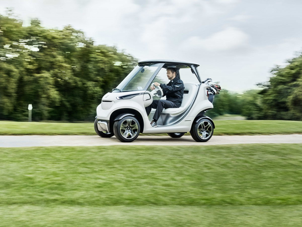 a real sports car garia luxury golf car